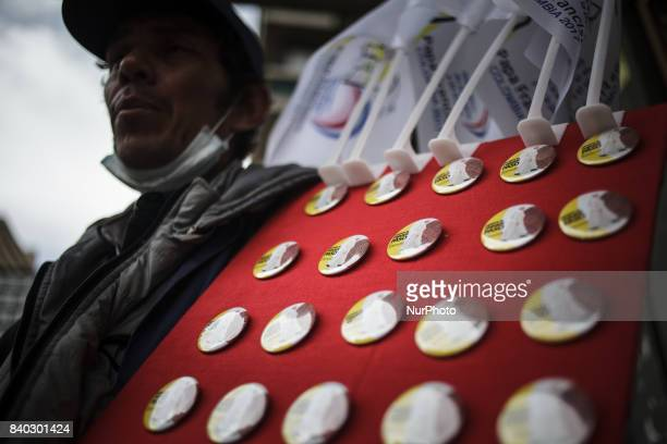 In this Picture Pope Francis souvenirs: bubbleheads, books, pope statues, buttons for sale at the streets in Bogota, Colombia. Pope Francis will...