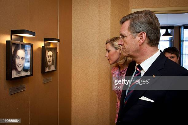 In this picture provided by the German Government Press Office German President Christian Wulff and his wife Bettina look at a photography of Anne...
