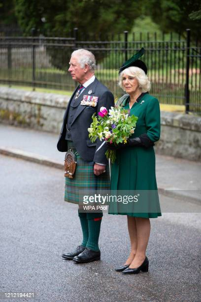 In this picture released by Clarence House Prince Charles Prince of Wales and Camilla Duchess of Cornwall observe a two minute silence to mark the...