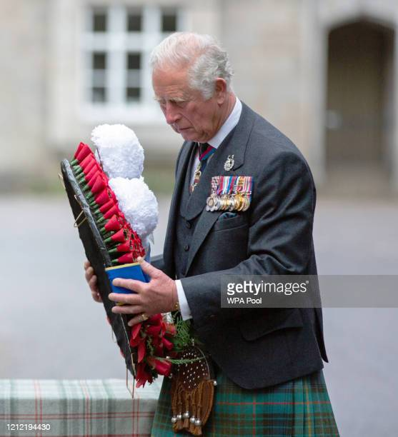 In this picture released by Clarence House, Prince Charles, Prince of Wales lays a wreath after observing a two minute silence to mark the 75th...