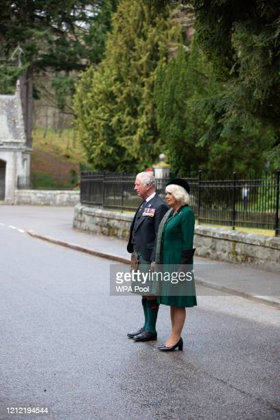 In this picture released by Clarence House Prince Charles Prince of Wales and Camilla Duchess of Cornwall take part in a two minute silence to mark...