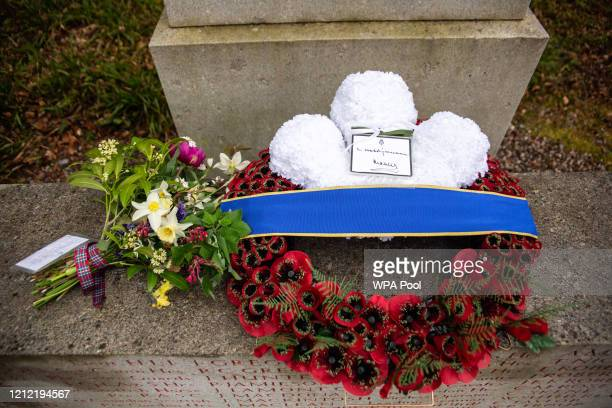 In this picture released by Clarence House, Wreath and flowers laid by Prince Charles, Prince of Wales and Camilla, Duchess of Cornwall during an...