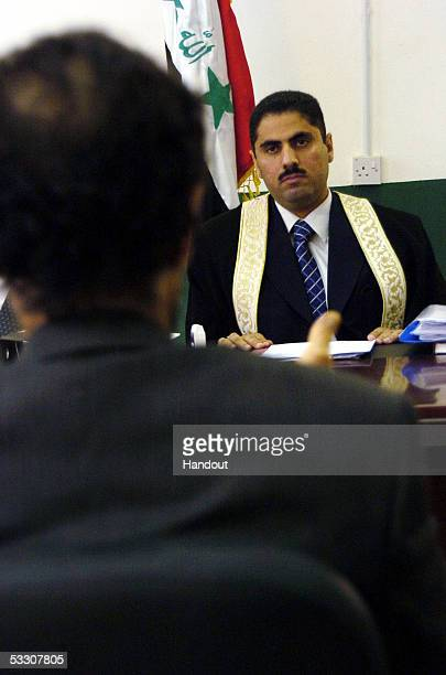 In this picture released by the Iraqi Special Tribunal on June 13 Iraqi special tribunal's chief investigating judge Raed Jouhi questions Iraqs...
