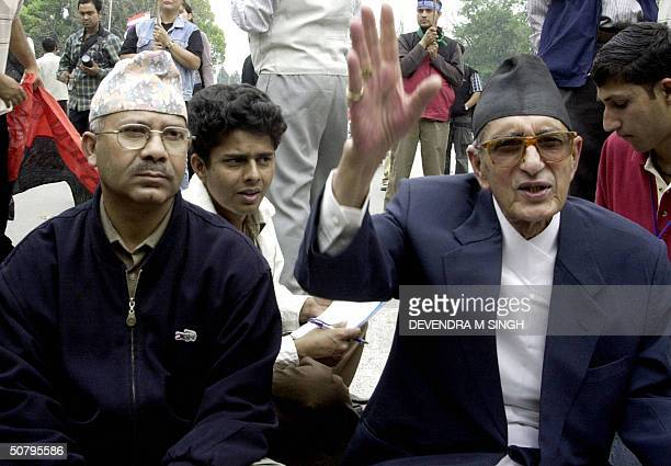 In this picture taken 02 April 2004 Nepali Congress President Girija Prasad Koirala accompanied by General Secretary of Nepal CommunistParty United...