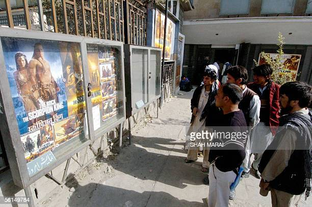 WITH AFGHANISTANFILMMEDIAFRANCETALIBAN In this picture taken 02 November 2005 Afghan men look at film posters outside the Ariana Cinema in Kabul...