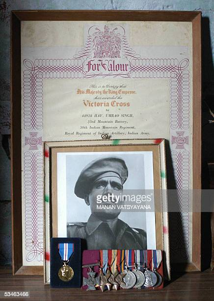 SINGH In this picture taken 04 August 2005shows medals photographs and citations of India's World War II soldier and Victoria Cross holder Umrao...