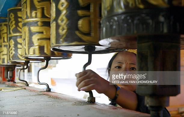 WITH 'CHINAINDIATIBETBORDERTRADERELIGION' In this picture taken 04 July 2006 an Indian Buddhist woman rotates the prayer wheels at a monastery in...