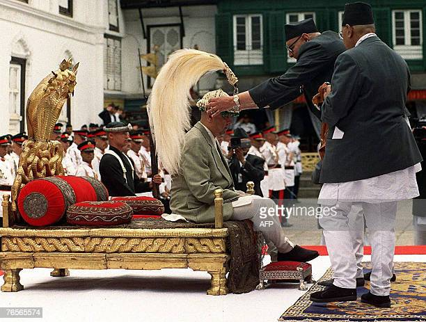 In this picture taken 04 June 2001 Nepal's King Gyanendra is crowned by Chief Priest Achut Prasad Upadhyaya as new King of Nepal in ancient Palace...