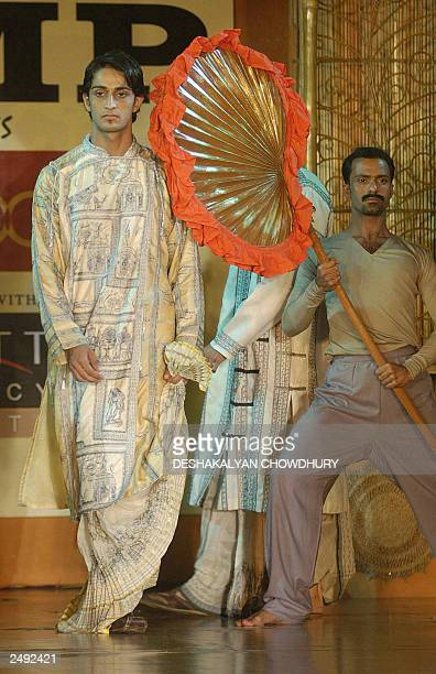 In this picture taken 06 September 2003 an Indian male model displays a creation by Indian designer Sharbari Datta during a choreographed fashion...