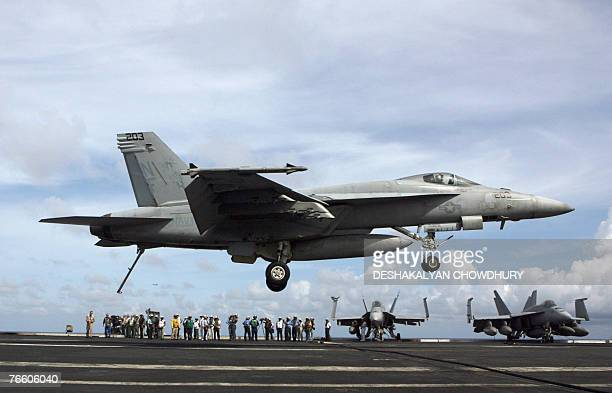 In this picture taken 07 September 2007, a US F-18 fighter plane prepares to touch down on the deck of USS Kitty Hawk aircraft carrier in the Bay of...