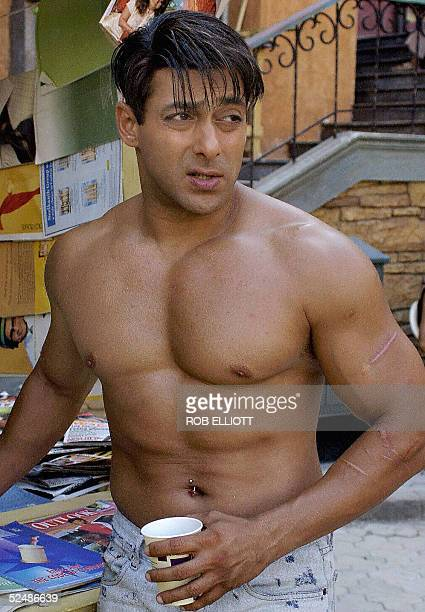 In this picture taken 08 December 2003 Indian Bollywood actor Salman Khan has a cup of coffee during a break from shooting an action scene in the new...