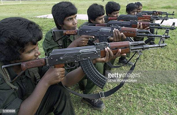 In this picture taken 09 March 2004 Female troops loyal to renegade regional commander of the Liberation Tigers of Tamil Eelam V Muralitharan better...