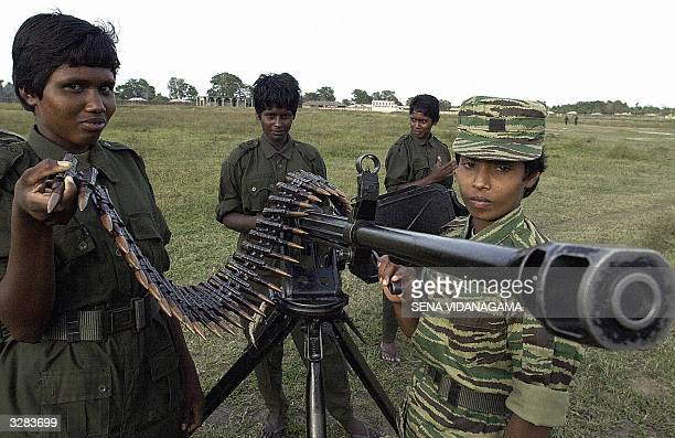 In this picture taken 09 March 2004 Female trrops loyal to renegade regional commander of the Liberation Tigers of Tamil Eelam V Muralitharan better...