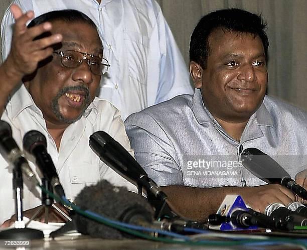 In this picture taken 10 April 2002 Sri Lankan Tamil Tiger guerrilla leader Velupillai Prabhakaran smiles while his chief negotiator Anton...