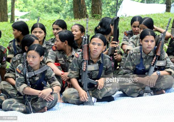 In this picture taken 10 November 2006 Nepalese Maoist rebels rest up during training at a camp in Makwanpur district some 120 Kms south of Kathmandu...