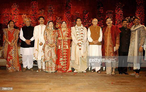 In this picture taken 14 February 2004 India's Deputy Prime Minister LK Avani poses alongside Sahara Group Chief Subrato Roy at his younger son...