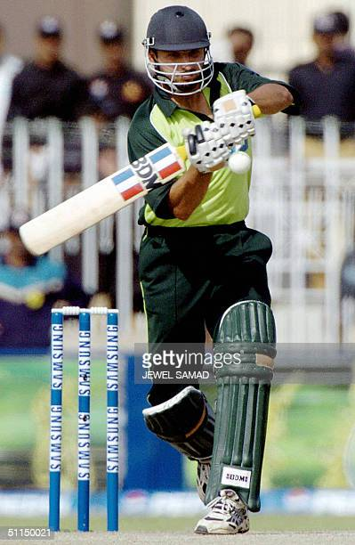 In this picture taken 16 March 2004 Pakistani cricketer Shahid Afridi hits a boundary off Indian pace bowler Zaheer Khan during the second One Day...