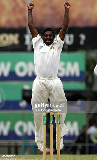 In this picture taken 16 March 2004 Sri Lankan off spinner Muttiah Muralitharan celebrates claming his 500th Test wicket during the first day of the...
