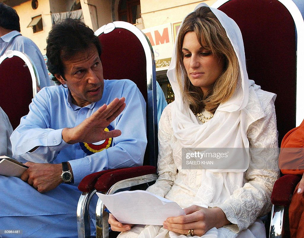 In this picture taken 16 September 2002, Jemima Khan (R) wife of Pakistan's cricket legend turned politician Imran Khan, reads her prepared statement in local Urdu language as Khan looks on during a public rally to boost her husband's election campaign in Islamabad. Khan and his wife Jemima have divorced, family and party officials have indicated 22 June 2004. Jemima, the daughter of multimillionaire British businessman James Goldsmith and Khan have two sons. Khan led Pakistan to victory in the cricket World Cup in 1992 and later formed his own political party in 1996. AFP PHOTO/ Saeed KHAN
