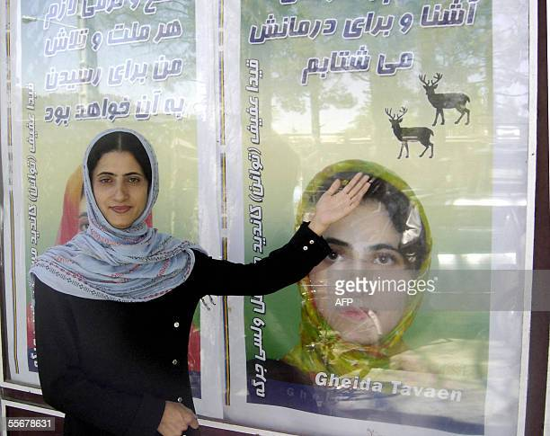 In this picture taken 18 August 2005 Gheida Tavaen Afif 26yearold candidate to the 'Walesi Jirga' poses outside her office while showing one of her...
