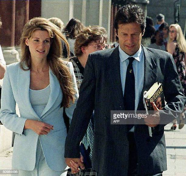 In this picture taken 18 July 1996 Former Pakistan cricket captain Imran Khan is accompanied by his wife Jemima as he arrives at the High Court in...