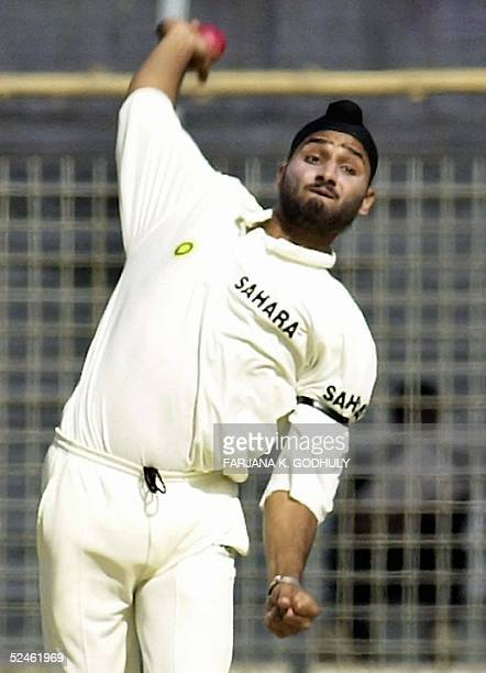 In this picture taken 19 December 2004 Indian cricketer Harbhajan Singh delivers a ball during the third day of the second Test match between...