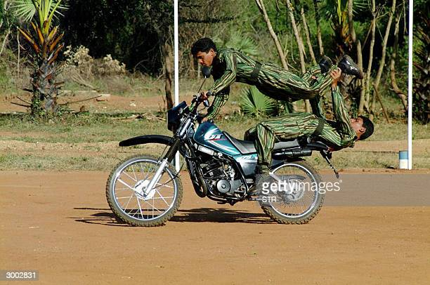 In this picture taken 20 February 2004 Sri Lankan Tamil Tiger rebels put on a display at a passing out parade of a new commandostyle motorcycle unit...