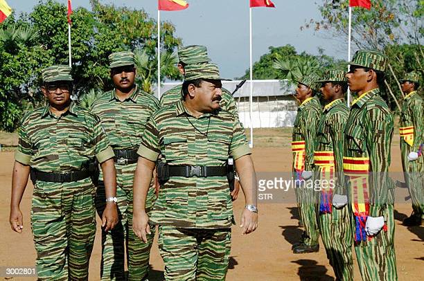 In this picture taken 20 February 2004 Sri Lanka's top Tamil Tiger leader Velupillai Prabhakaran inspects the passing out parade of a new...