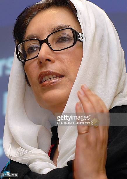 In this picture taken 20 July 2007 shows former Pakistani prime minister Benazir Bhutto who currently chairs the Pakistan People's Party gesturing as...