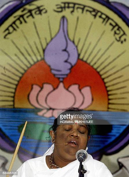 In this picture taken 21 February 2004 Indian Hindu spiritual leader Mata Amritanandamayi chants mantras or prayers as she blesses her followers...