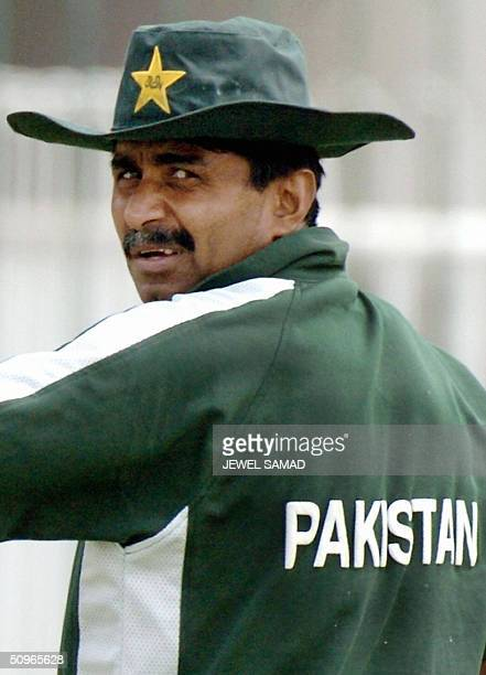 In this picture taken 23 March 2004 Pakistani cricket team coach Javed Miandad looks back at Indian cricketers during a practice session in Lahore...