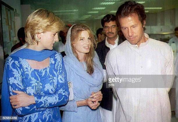 In this picture taken 23 May 1997, The late Princess of Wales is given a tour of Imran Khan's charity cancer hospital with Khan and his wife Jemima...