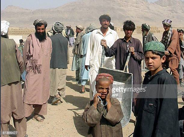 In this picture taken 24 September 2004 refugees go about their daily lives at the Zare Dashte camp in the Kandahar province of southern Afghanistan...
