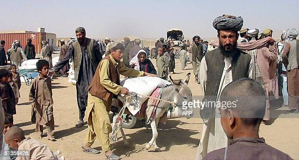 In this picture taken, 24 September 2004, refugees go about their daily lives at the Zare Dashte camp in the Kandahar province of southern...