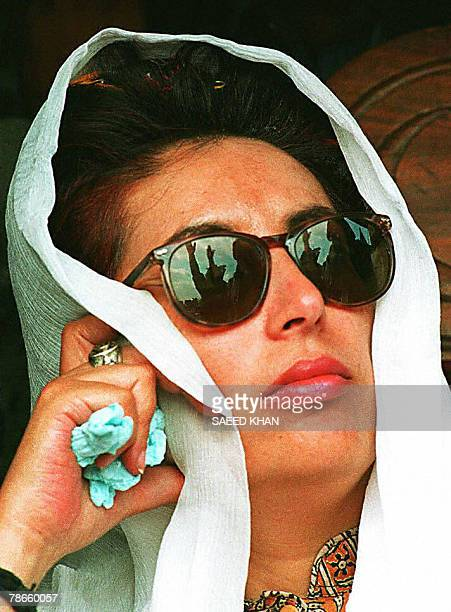 In this picture taken 27 January 1997, then deposed Pakistani Premier Benazir Bhutto contemplates proceedings prior to addressing a public meeting in...