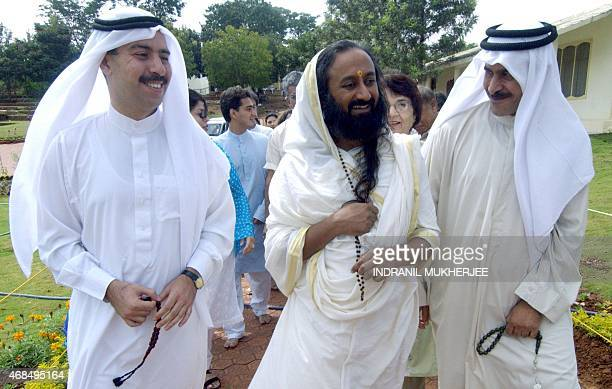 In this picture taken 28 August 2004 Indian spiritual leader and founder of The Art of Living Foundation Sri Sri Ravi Shankar laughs as he interacts...