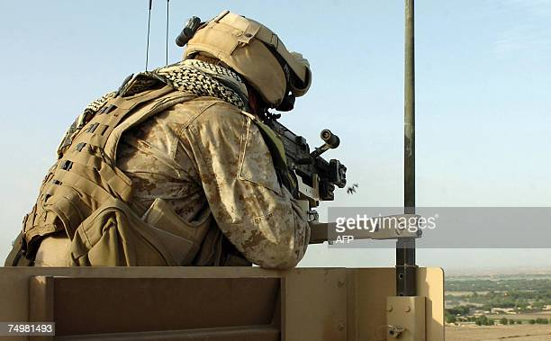 In this picture taken 29 June 2007 A Coalition force sniper fires on an enemy position in Shurakian in Helmand province The foreign forces in...