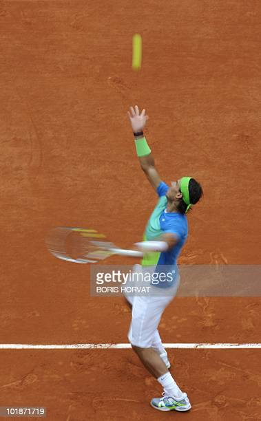 In this picture taken at a slow shutter speed Spain's Rafael Nadal serves during his men's fourth round match against Brazil's Thomaz Bellucci in the...