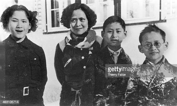 In this picture taken circa 1934 during the winter in Switzerland the future king of Thailand Bhumibol Adulyadej stands with his mother princess...