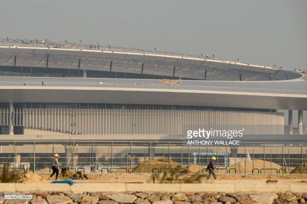 In this picture taken in Macau on December 6 labourers work on the rooftop of a building on an artificial island which was built for the Hong...