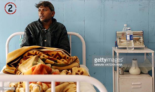In this picture taken January 29 Indian labourer Mohammad Salim rests on a hospital bed in Gurgaon some 30 kms south of New Delhi after one of his...