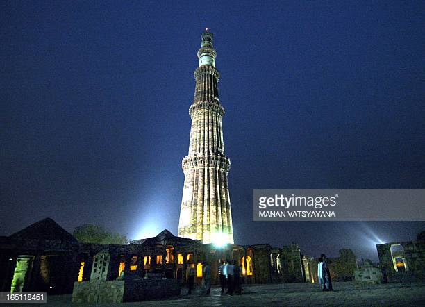 In this picture taken late 13 May 2005 Indian monument Qutab Minar is illuminated in New Delhi after it was opened for night viewing for the general...