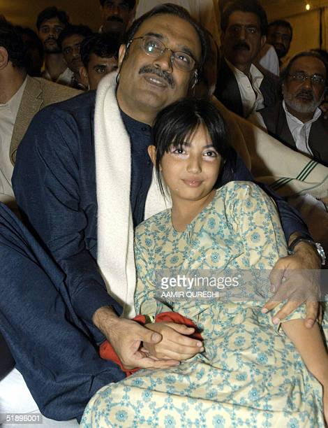 In this picture taken late 26 December 2004, Asif Ali Zardari, husband of former Pakistani Prime Minister Benazir Bhutto, sits with his daughter...