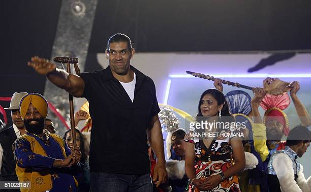 In this picture taken late May 7 2008 Indian Wrestler of the World Wrestling Entertainment The Great Khali waves to his fan at a show as his wife...