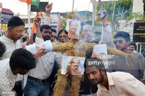 In this picture taken May 5 Aam Admi Party supporters burn an effigy of Jharkhand Chief Minister Raghubar Das during a protest rally following the...