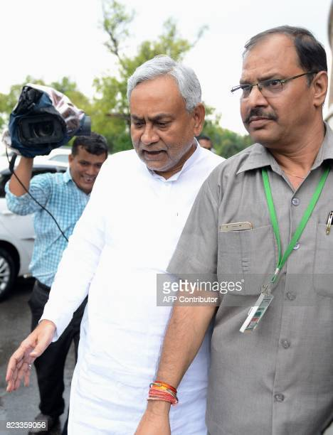 In this picture taken on 25 July 2017 Bihar state Chief Minister Nitish Kumar leaves the Indian parliament after attending the oathtaking ceremony of...