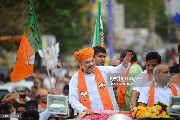 In this picture taken on April 14 Amit Shah Bhartiya Janta Party President waves to his supporters during his road show at Kalol town some 30 km from...