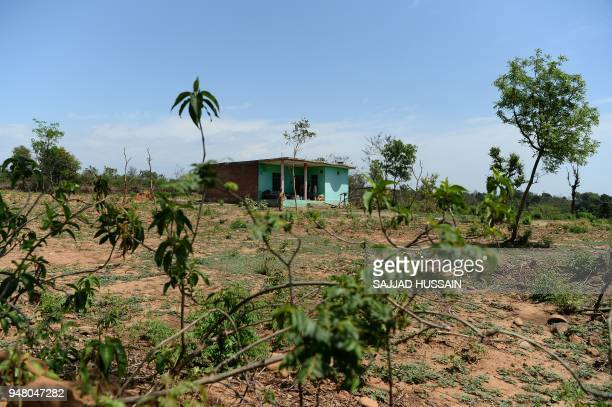 In this picture taken on April 17 an Indian policemen guard the house of the eightyearold girl who was raped and murdered at Rasana village in Kathua...