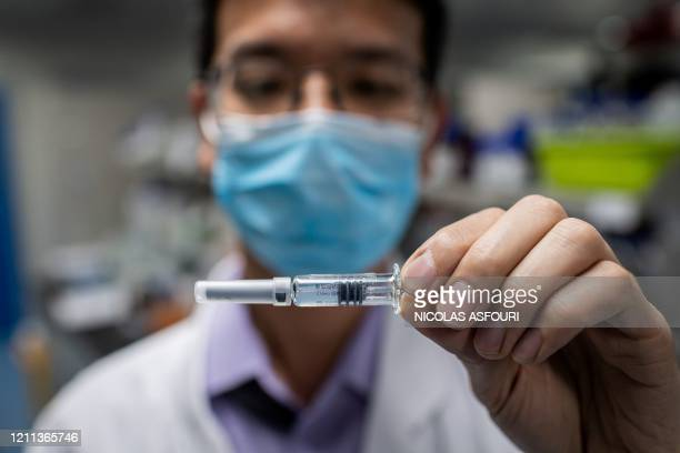 In this picture taken on April 29 an engineer shows an experimental vaccine for the COVID-19 coronavirus that was tested at the Quality Control...