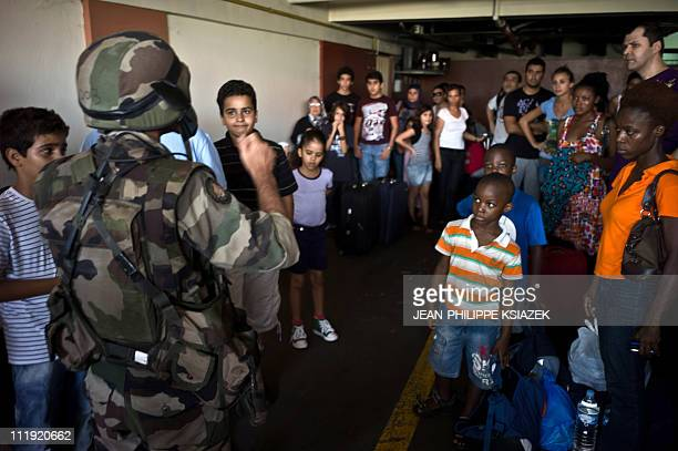 In this picture taken on April 7 2011 a French soldiers speaks to civillians prior to their evacuation in Abidjan A spokesman for Ivory Coast...